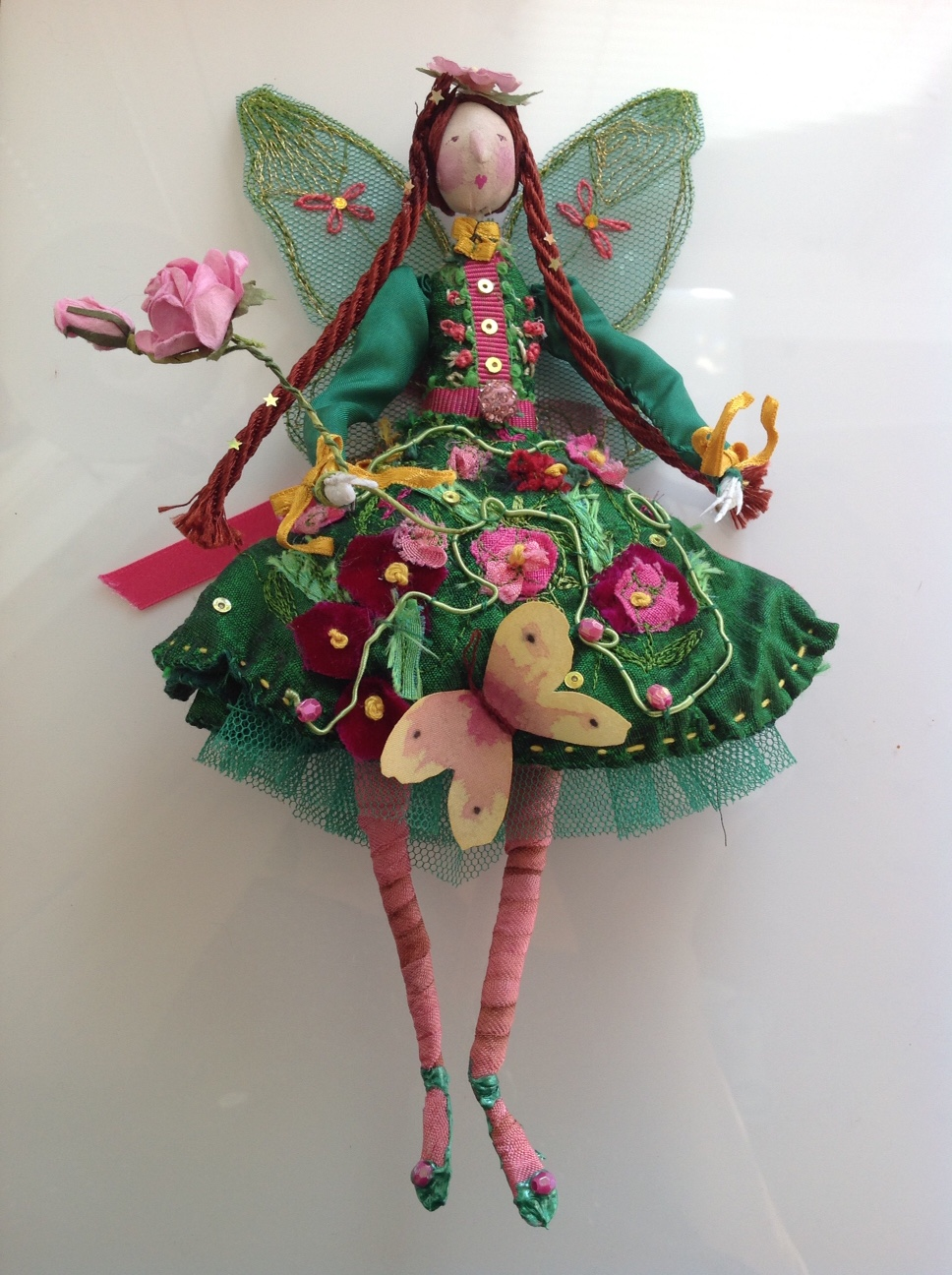 GARDENIA A 22cm fairy. She is wearing a silk dress embroidered with flowers, bows and a silk butterfly. She is embellished with sequins and jewels and carrying a paper rose wand. her wings are stiff net and embodied with gold thread. She comes in an organza bag with a hand painted name tag. £ 50 plus £3.50 p&p.