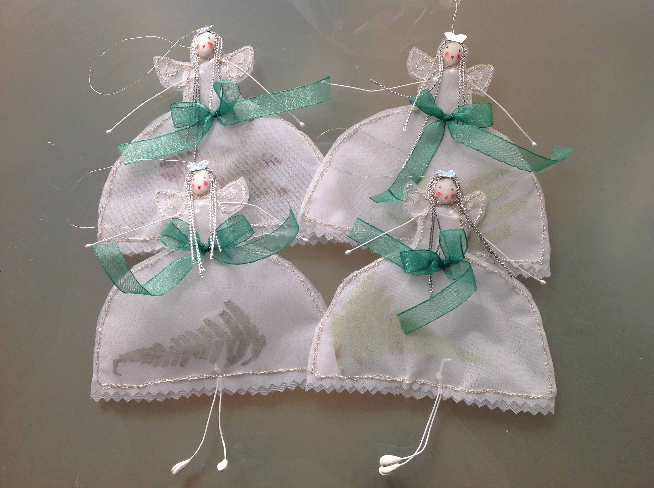 14cm high transparent stiff white organdie fairies with fern/evergreen dried leaves inserted. £9.50 including postage.