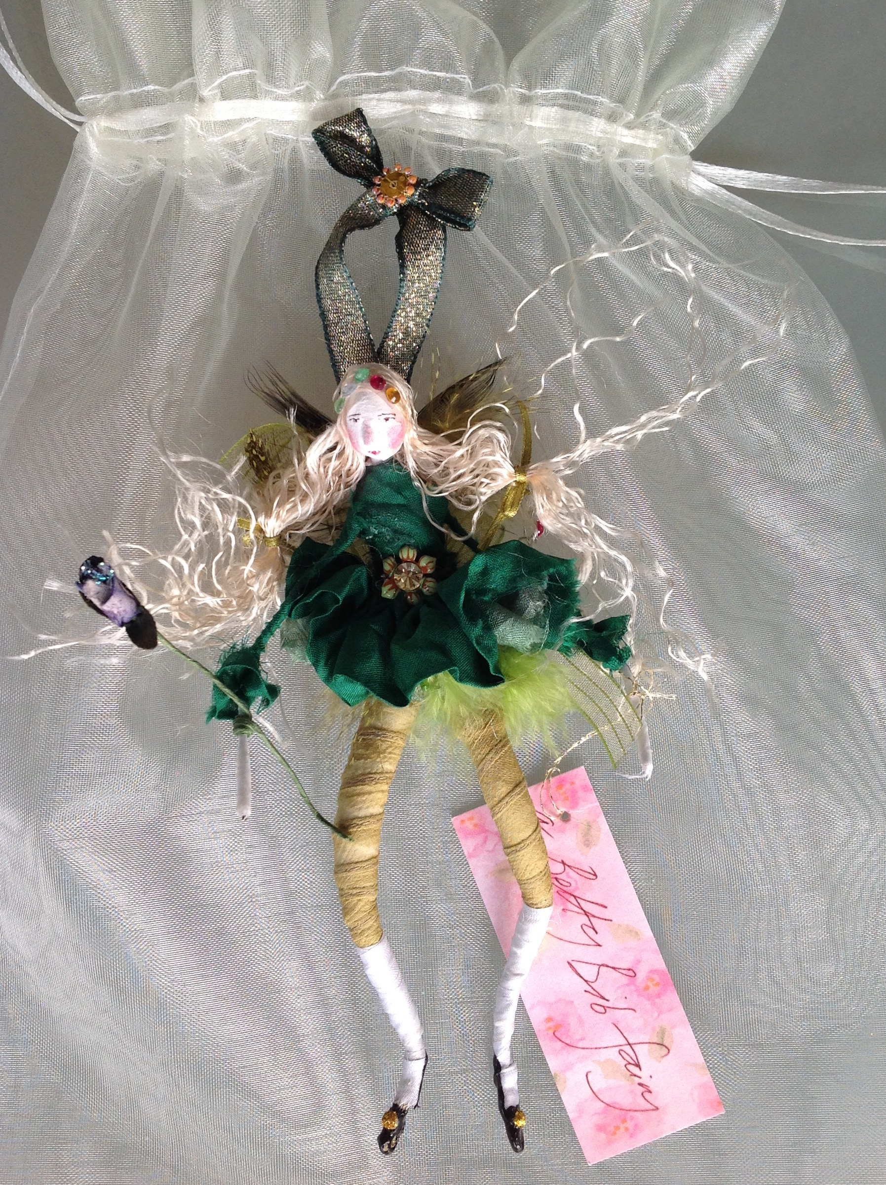 15cm high fairy with silk tutu, feather wings and jewel on her waistband. £28 plus £3.50 p&p
