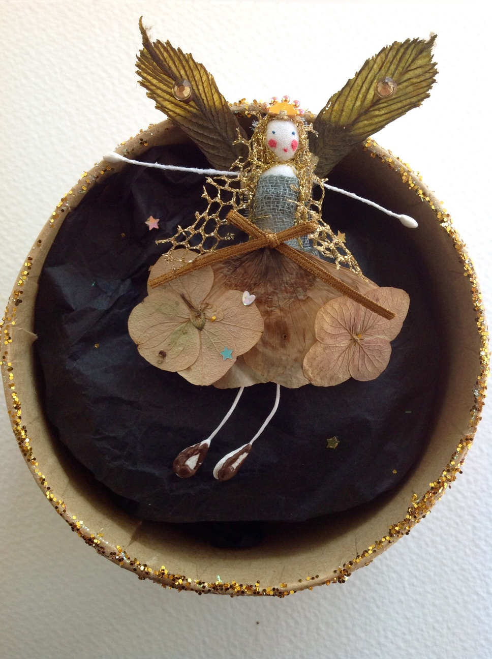 AUTUMN A 9cm fairy in a box with her name in the lid. Dressed in poppy and lace cap flowers and chestnut leaves. £15 plus £3.50 p&p