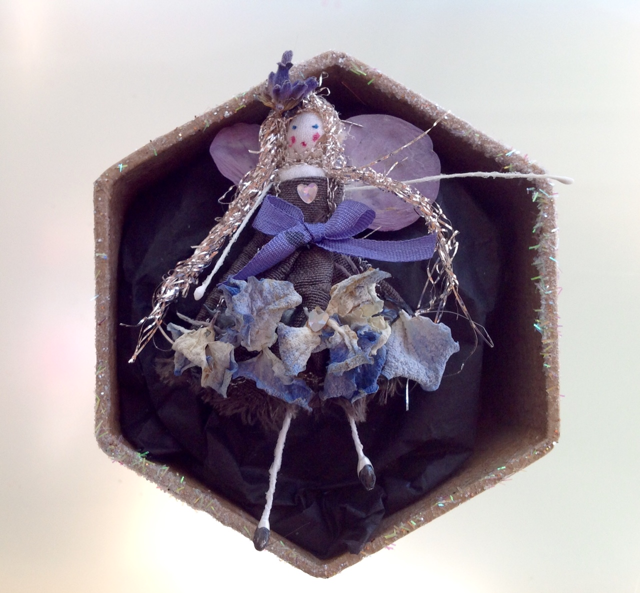 A 6 cm boxed fairy with her name in the lid. Dressed in dried hydrangea and lavender. £12 plus £3.50 p&p.