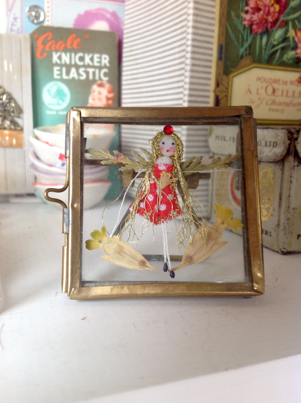 5cm square brass frame with stand. Polka dot fairy with dried cowslips and cypress. £14 plus £1 p&p.