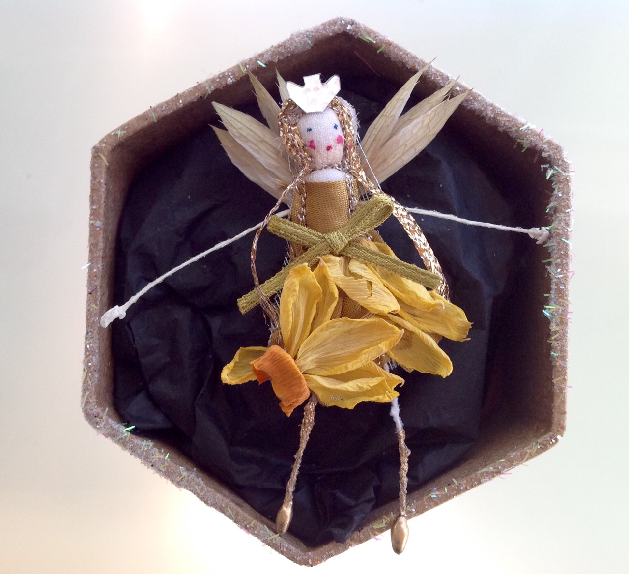 A 6cm boxed fairy with her name in the lid. Dressed in dried narcissus and astrantia. £12 plus £3.50 p&p.