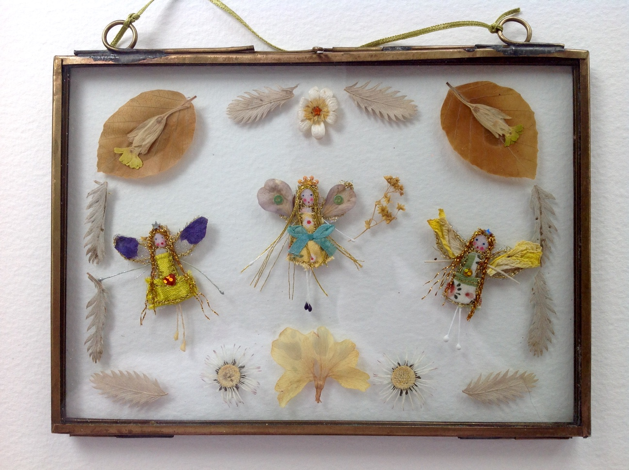 17.5x12.5 cm brass framed fairies. with dried cowslips, daisies and beech leaves. £35 plus £3 p&p.