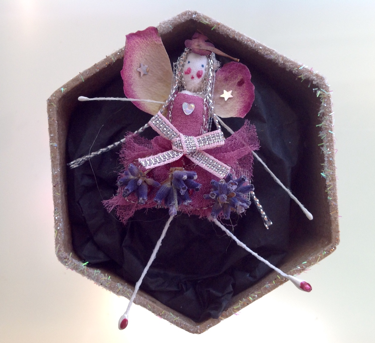 A 6 cm boxed fairy with her name in the lid. Dressed in dried rose and lavender. £12 plus £3.50 p&p.