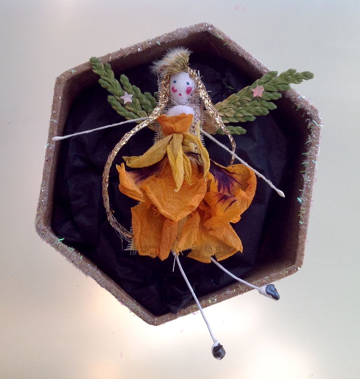 A 6 cm boxed fairy with her name in the lid. Dressed in dried nasturtium, narcissus and and cypress. £12 plus £3.50 p&p.