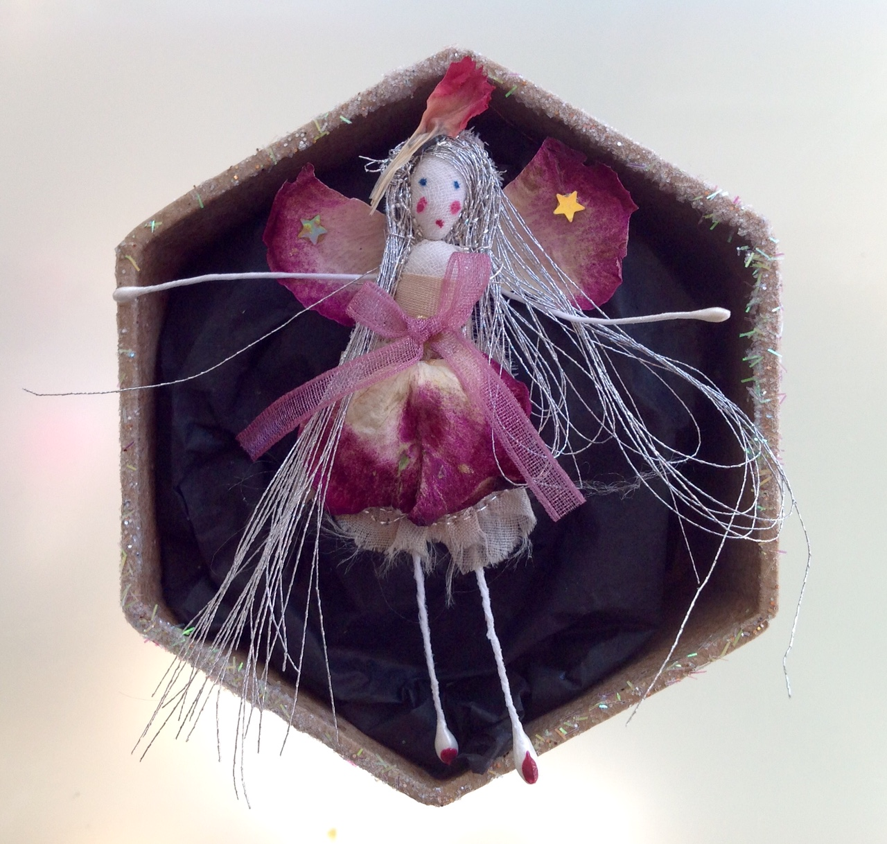 A 6cm fairy in a box with her name in the lid. Dressed in dried rose and pink petals. £12 plus £3.50 p&p
