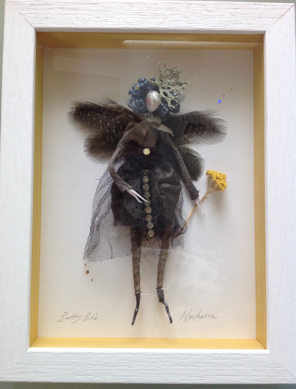 NOCTURNE ; a 23x17.5 cm boxed fairy. She is wearing hand dyed clothes ( alder cones ) trimmed with vintage diamante, has a dried lichen hat and dyed guinea feather wings. She is holding a piece of dried yarrow. £95 plus £3.50 postage. Please e mail me if you would like to see her in more detail.