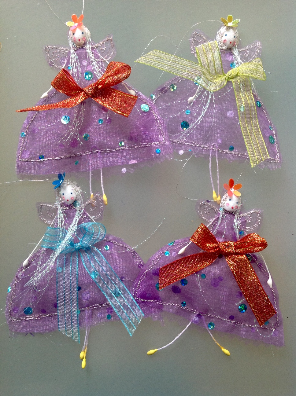 10cm hanging fairies, wearing purple organza ... £4.50 each or 4 for £16 plus £1 postage.