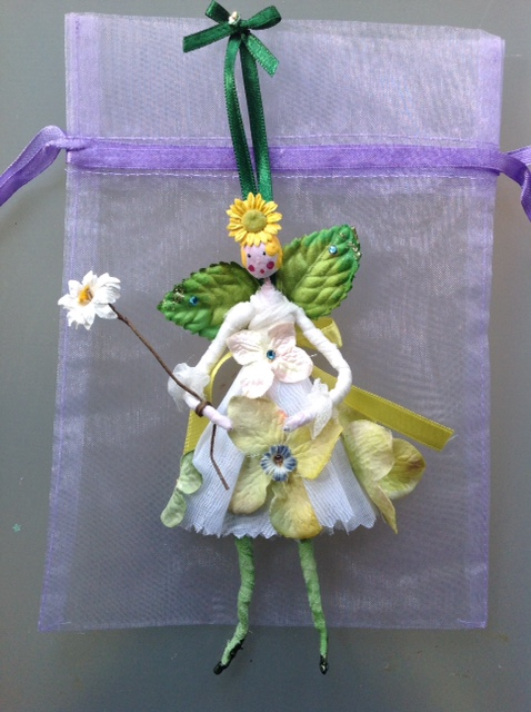 Primrose A 13cm fairy with a paper clay head. She has paper wings and wandered is wearing a cotton organdie dress decorated with appliqué hand painted flowers. She comes in an organza bag with dried petals. A forgotten treasure she was £22, now £15 plus £2 p&p.