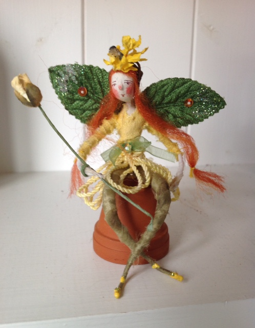Buttercup A 10cm high fairy with a paper clay head and plant dyed clothes. She has a paper headers and wand and comes with her terracotta flower pot. A forgotten treasure - she was £25 , now £15 plus £2 p&p