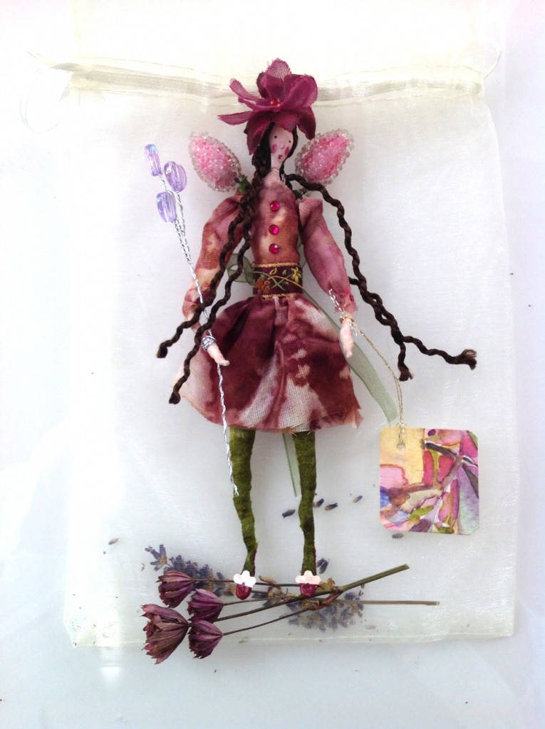 DAMSON; A 14 cm high fairy with a painted silk head. She is wearing an eco-dyed cotton organdie dress and comes with a hand painted name tag and in an organza bag with dried petals. £25 plus £2 p&p