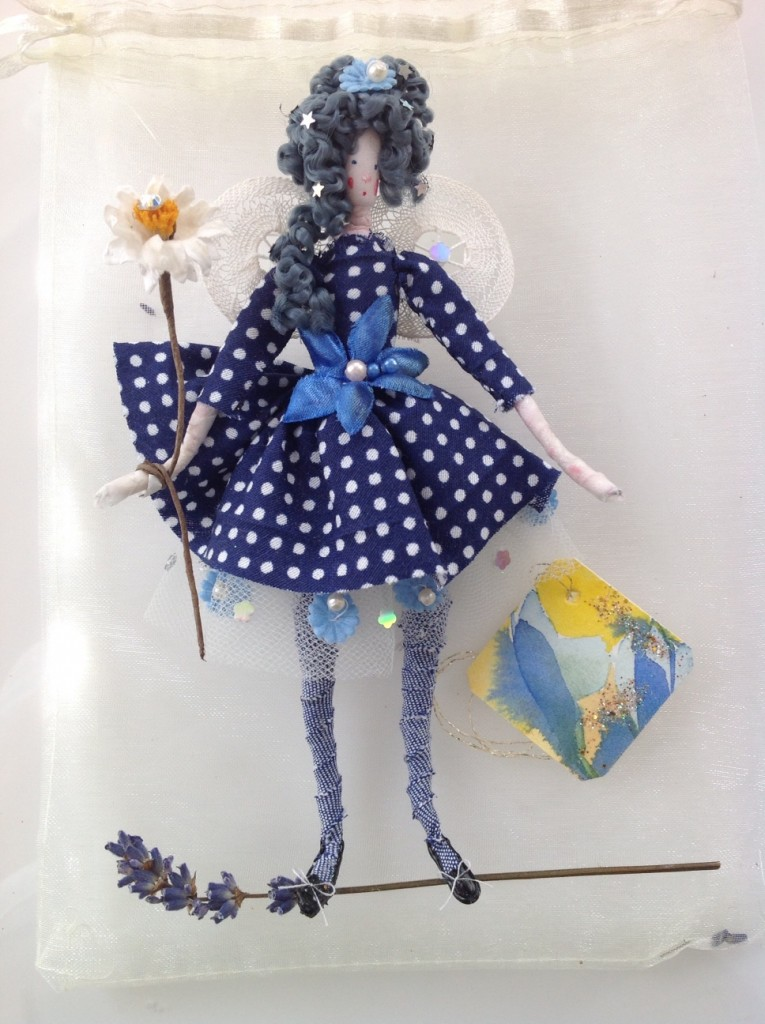 DOTTY; A 14cm high fairy with a painted silk head. She is wearing a cotton dress with a net petticoat and has lace wings. She comes with a hand painted name tag and in an organza bag with dried petals. £25 plus £2 p&p
