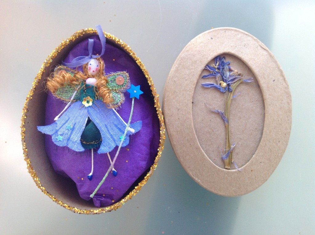 An 8cm oval boxed fairy with a hand painted silk  bluebell dress with a fine silk ribbon, embellished with sparkles ad sequins. Her name is in the box lid which has a pressed bluebell on it's top. £11.50 plus £3.50 P&P.