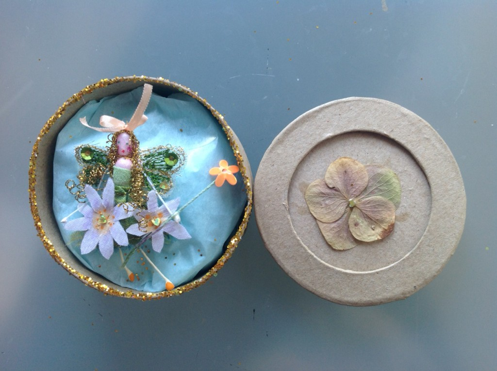 A 7cm round boxed fairy embroidered with hand- painted daisies, sequins and a fine silk ribbon. her name is in the lid which has a pressed hydrangea flower . £11.50 plus £3.50 P&P.