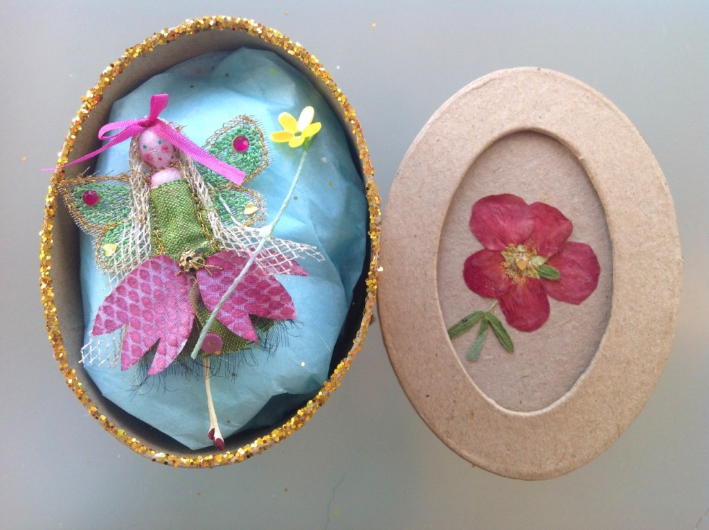 An 8cm oval boxed fairy with a hand painted snakeskin fritillary dress, embellished with sequins and a fine silk ribbon. Her name is in the lid of the box which has a pressed flower on it's top. £11.50 plus £3.50 P&P.
