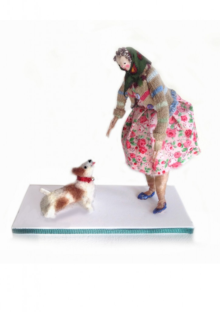 A 12 cm high silk painted head figure on a ribbon edged foam board base. The little terrier is needled felted . £50 including UK postage ( please email me for international postage).
